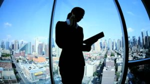 stock-footage-silhouette-young-female-caucasian-finance-manager-working-on-touch-screen-in-manhattan